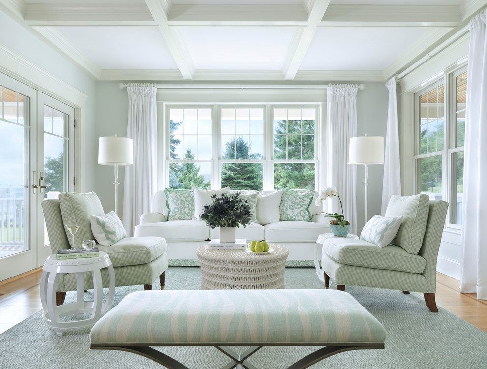 Example of a coastal medium tone wood floor living room design in Providence with white walls