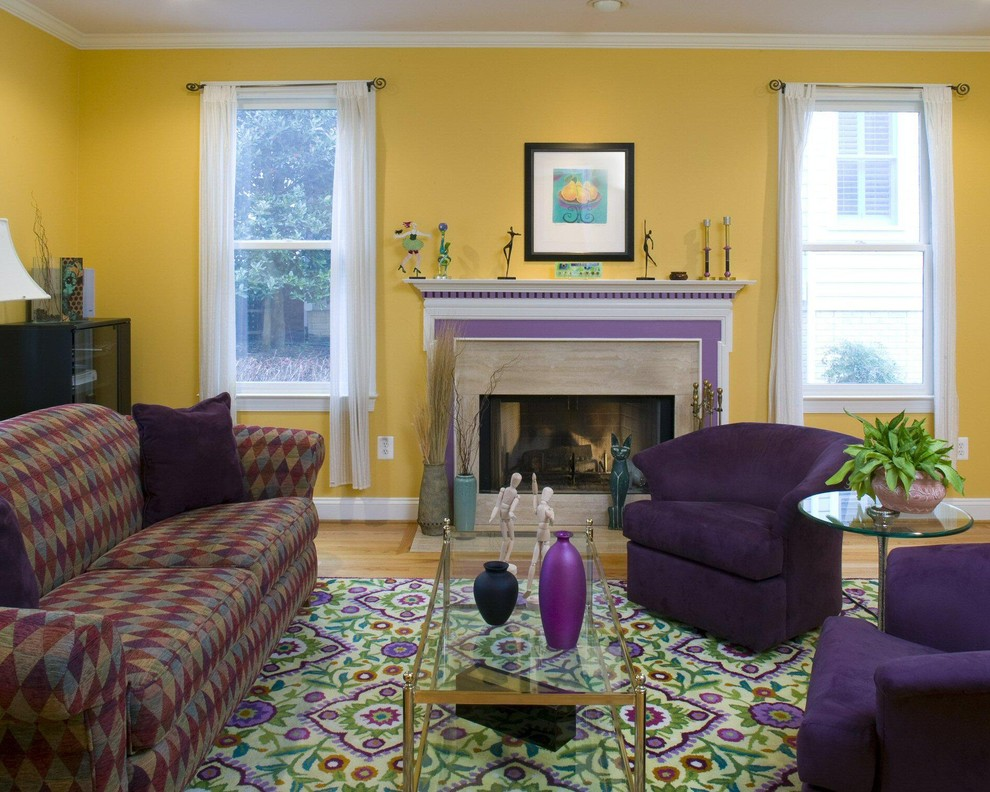 Example of an eclectic living room design in DC Metro with yellow walls