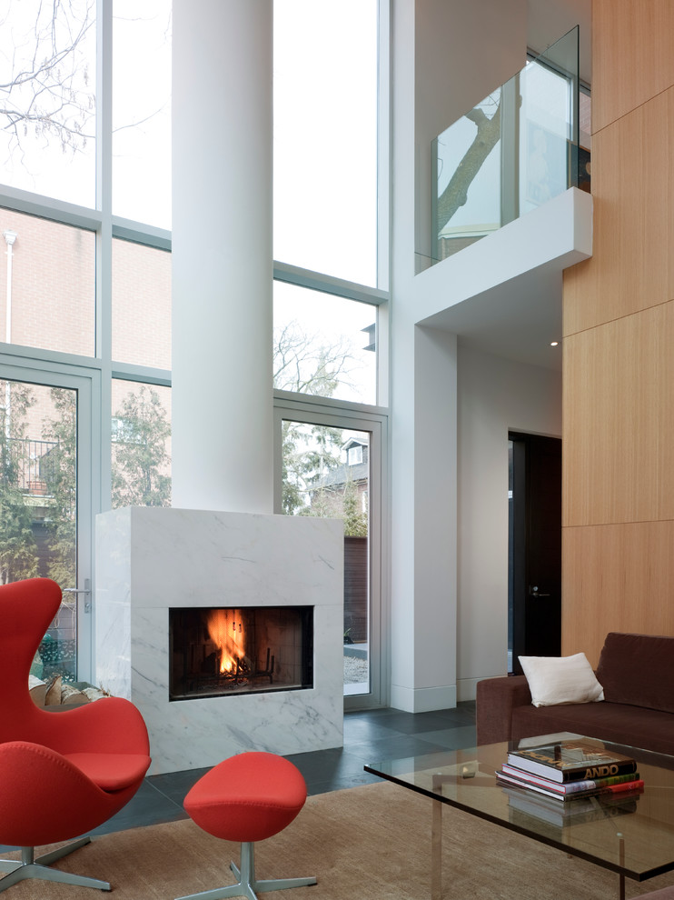 Inspiration for a contemporary living room remodel in Toronto with a standard fireplace and a stone fireplace