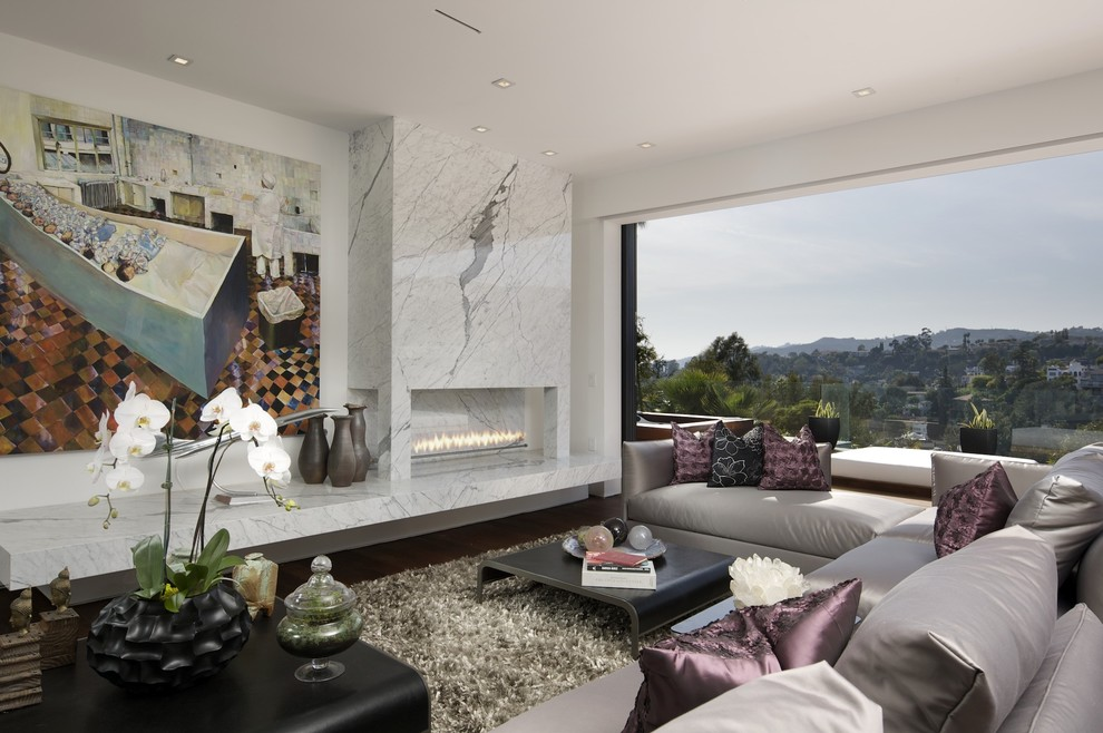 Example of a trendy living room design in Los Angeles with white walls and a ribbon fireplace