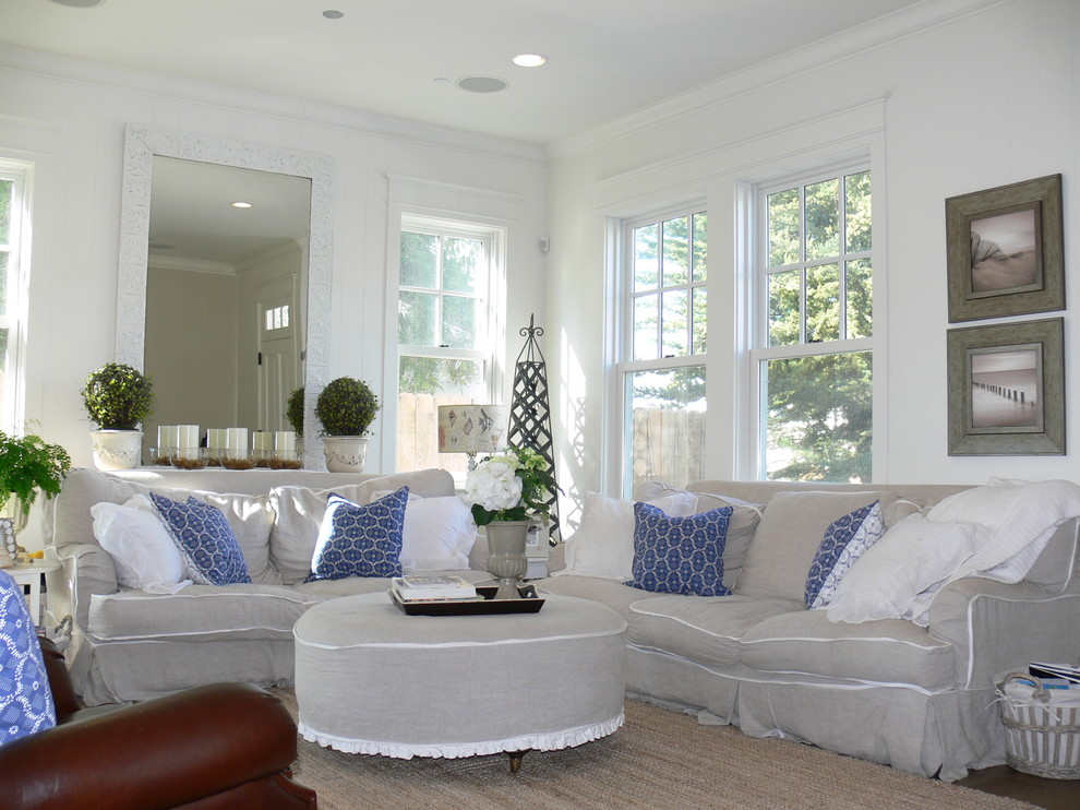 Example of a cottage chic living room design in San Diego with white walls