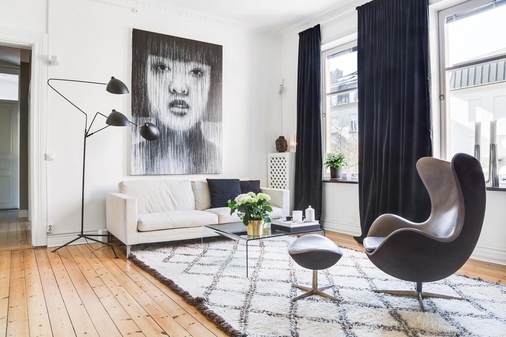 Living room - small scandinavian open concept light wood floor and beige floor living room idea in London with white walls