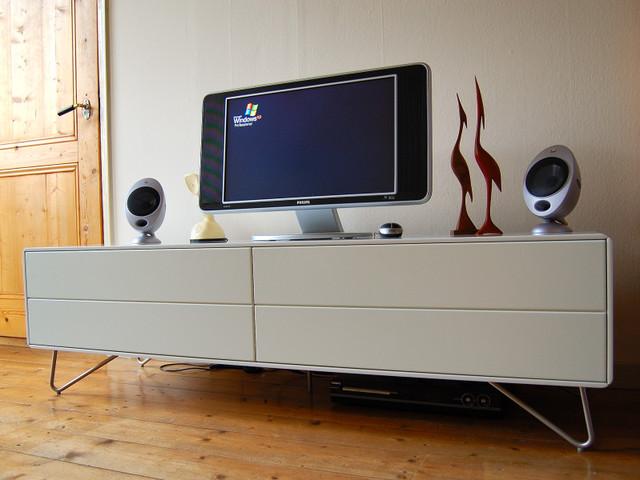 low board with tv set. Black Bedroom Furniture Sets. Home Design Ideas