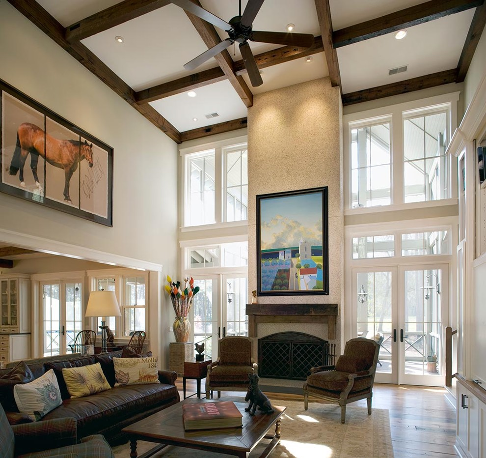 Living room - rustic living room idea in Charleston with a standard fireplace
