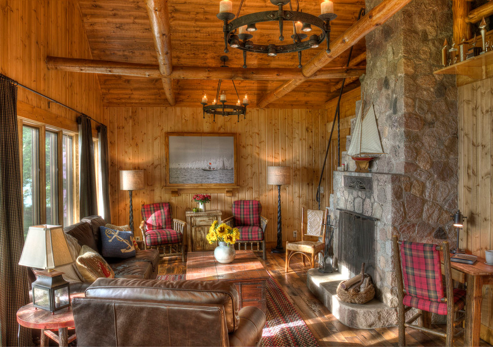 Small mountain style living room photo in Minneapolis with a stone fireplace
