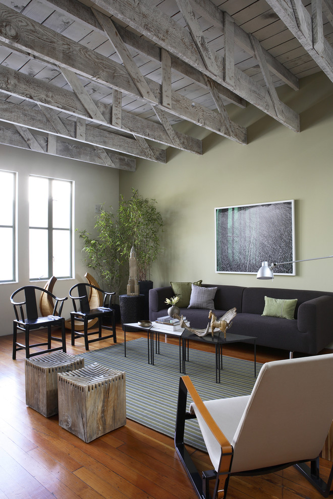 Living room - large rustic living room idea in San Francisco with green walls