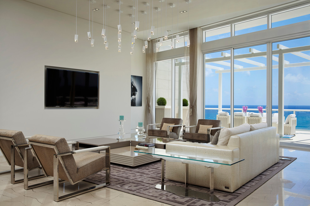 Living room - large contemporary formal and open concept marble floor living room idea in Miami with white walls and a wall-mounted tv