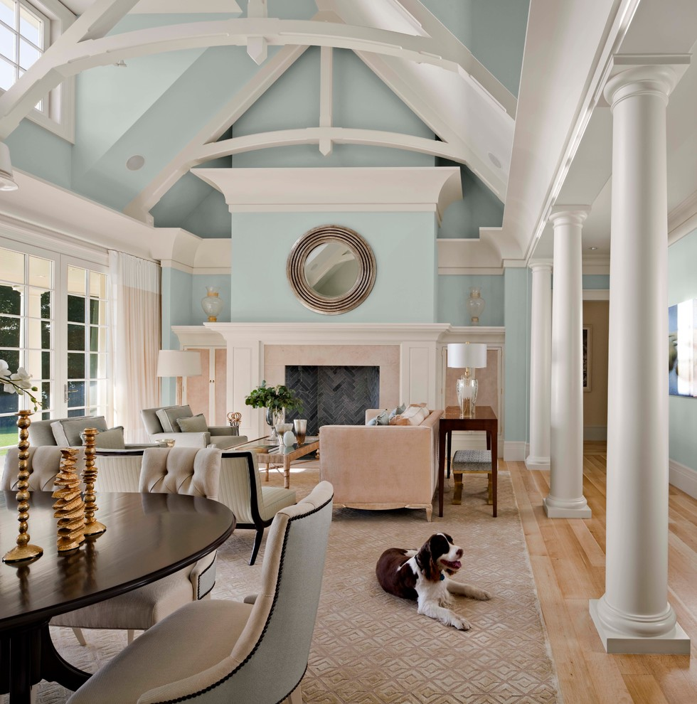 Inspiration for a large transitional formal and open concept light wood floor and beige floor living room remodel in Miami with blue walls, a standard fireplace, a tile fireplace and no tv