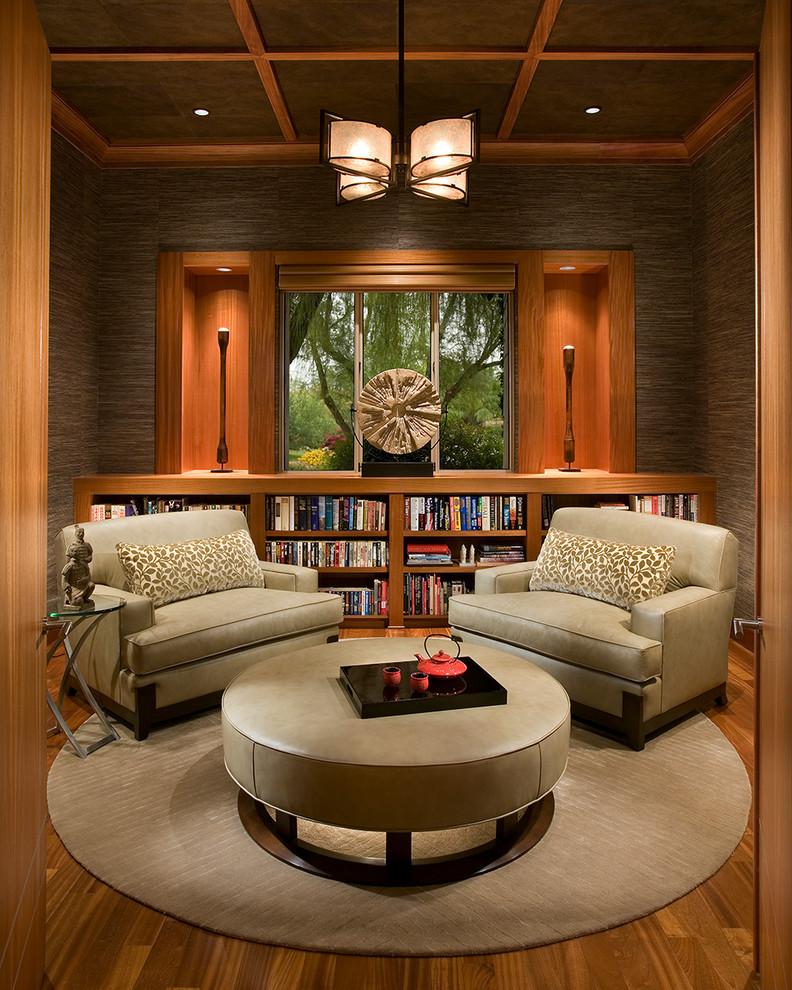 Zen enclosed medium tone wood floor living room library photo in Phoenix with brown walls