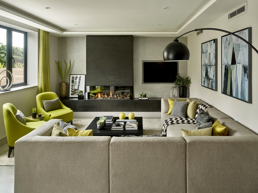 Trendy living room photo in Surrey with gray walls, a ribbon fireplace and a wall-mounted tv