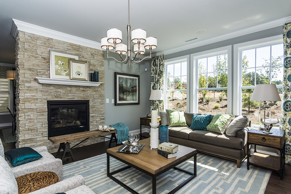 Living room - traditional living room idea in Raleigh with a stone fireplace