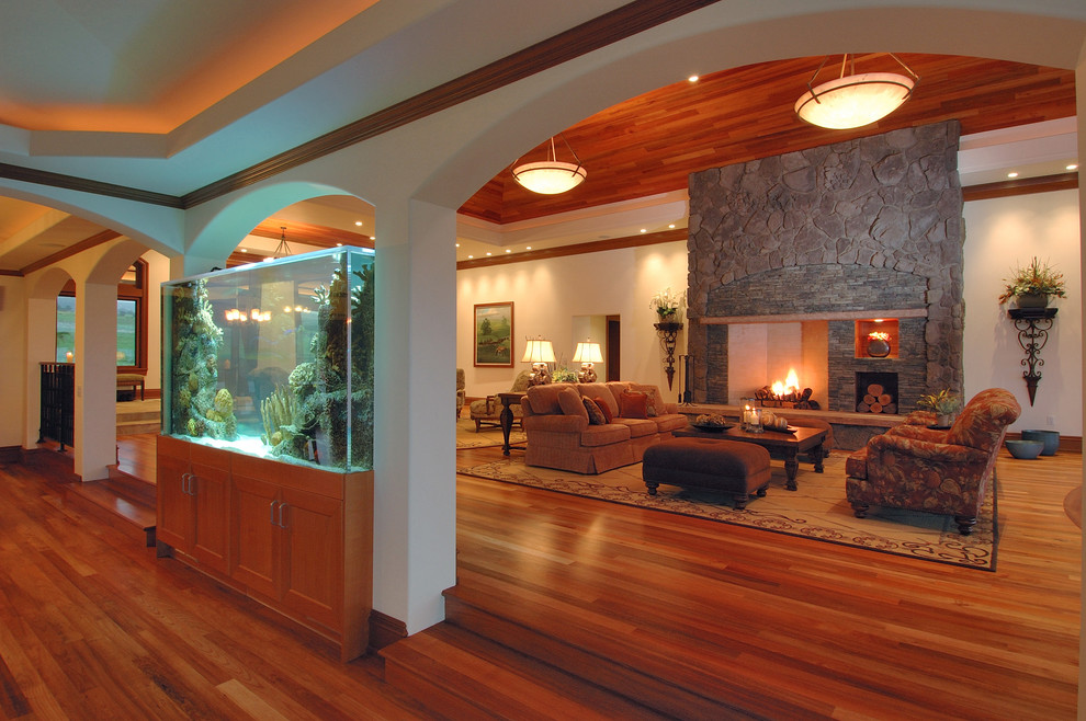 Example of a large trendy formal and open concept medium tone wood floor and brown floor living room design in Hawaii with a stone fireplace, white walls, a standard fireplace and no tv