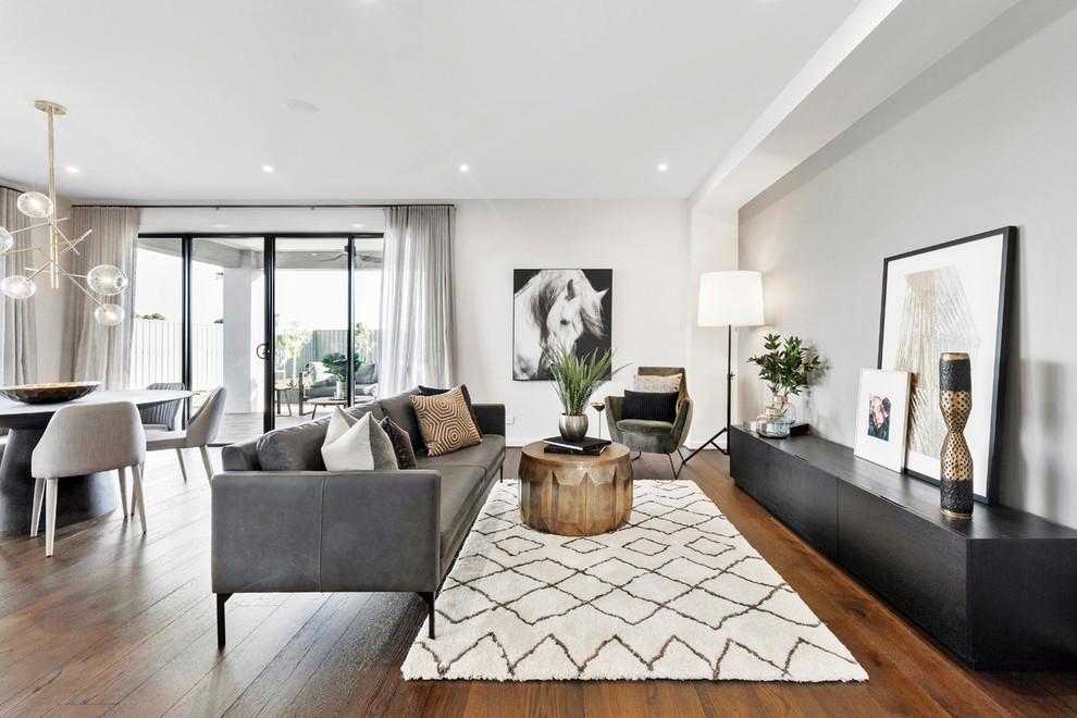 Example of a trendy dark wood floor and brown floor living room design in Melbourne with gray walls