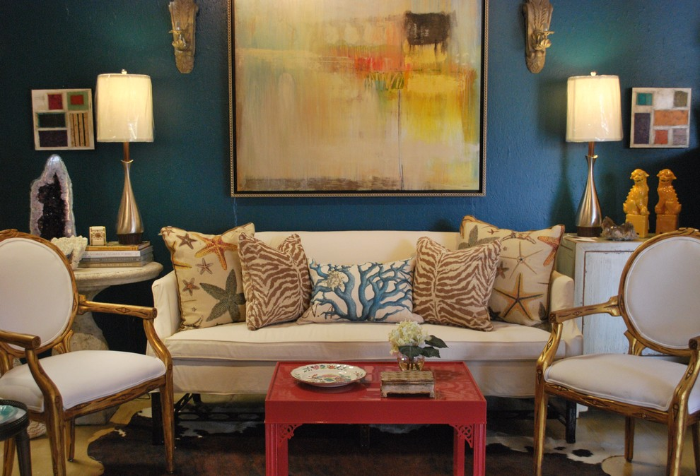 Example of an eclectic living room design in Other with blue walls