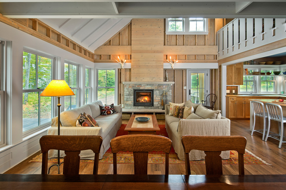 Example of a farmhouse formal and open concept living room design in Minneapolis with a standard fireplace and a stone fireplace