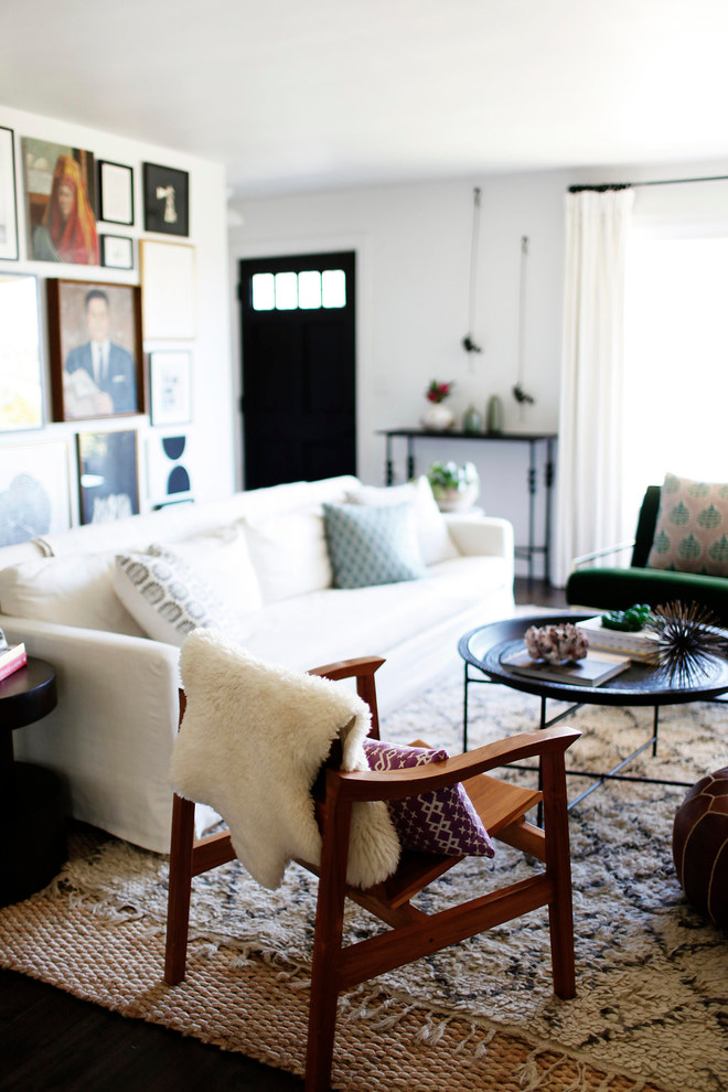 Inspiration for a mid-sized 1950s formal and enclosed dark wood floor living room remodel in Tampa with white walls, a standard fireplace, a tile fireplace and no tv