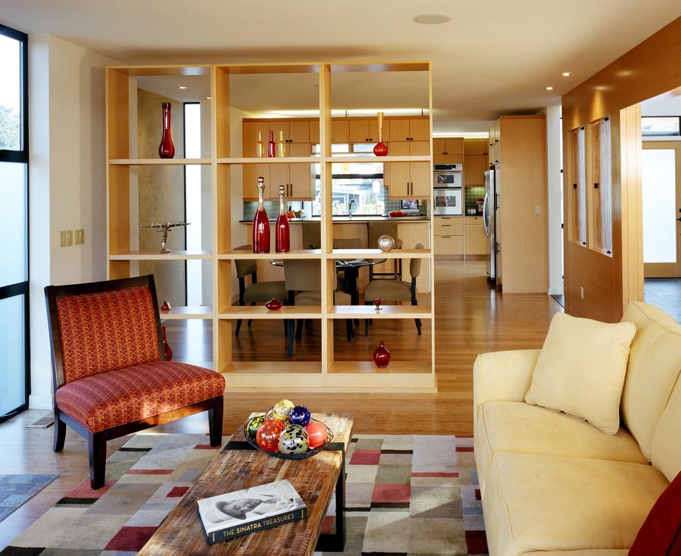 Living room - contemporary medium tone wood floor living room idea in Seattle