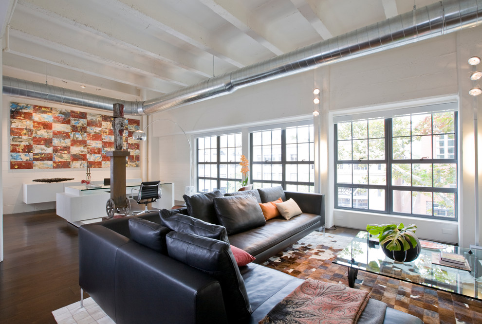 Example of a large urban open concept living room design in DC Metro with white walls
