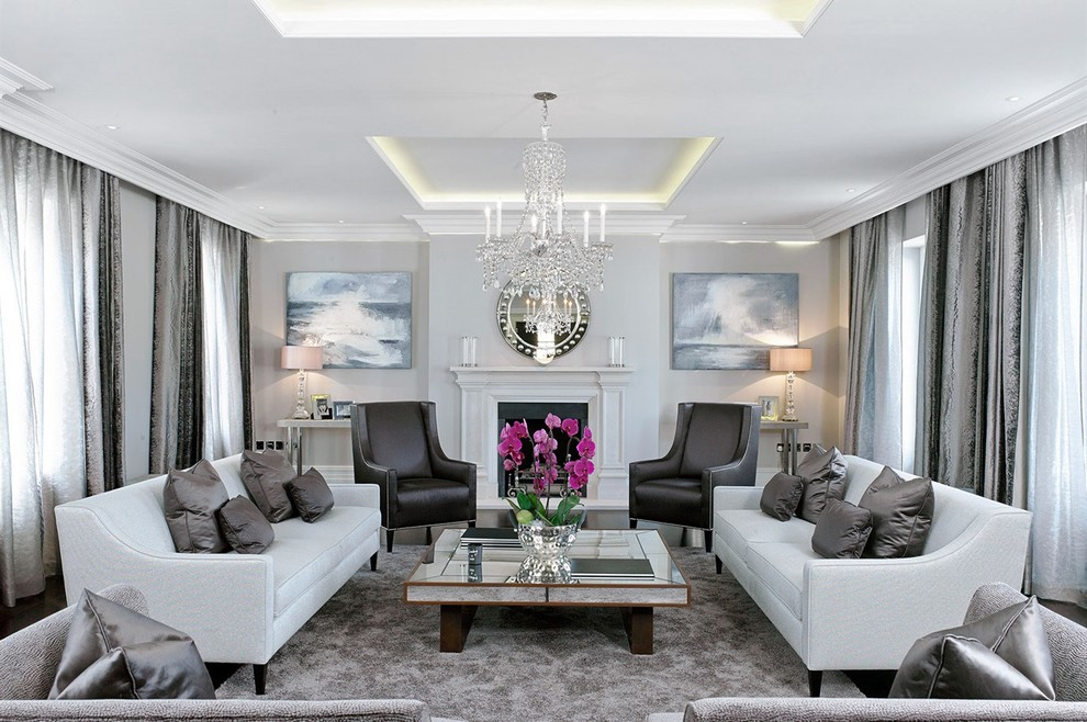 Inspiration for a large transitional formal living room remodel in London with gray walls and a standard fireplace