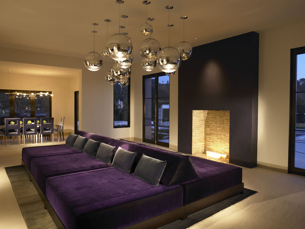 Example of a trendy open concept living room design in San Diego with beige walls and a standard fireplace