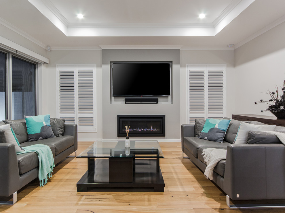 Inspiration for a contemporary formal and enclosed light wood floor and beige floor living room remodel in Perth with gray walls, a ribbon fireplace and a wall-mounted tv