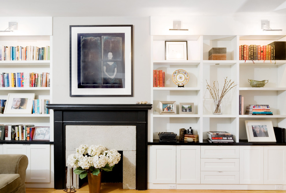 Example of a minimalist living room library design in Vancouver with a standard fireplace