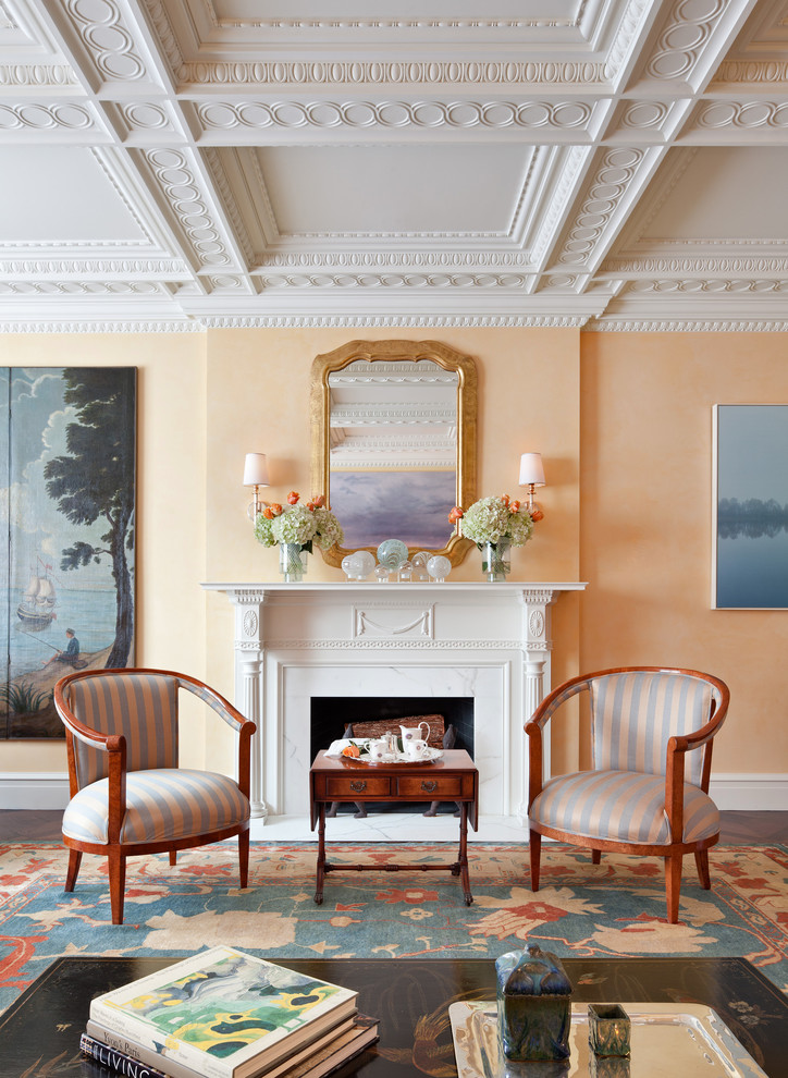 Inspiration for a large timeless formal and enclosed dark wood floor living room remodel in New York with orange walls, a standard fireplace, a wood fireplace surround and no tv