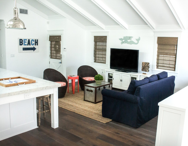 Living room - mid-sized beach style open concept dark wood floor and brown floor living room idea in Los Angeles with white walls and a tv stand