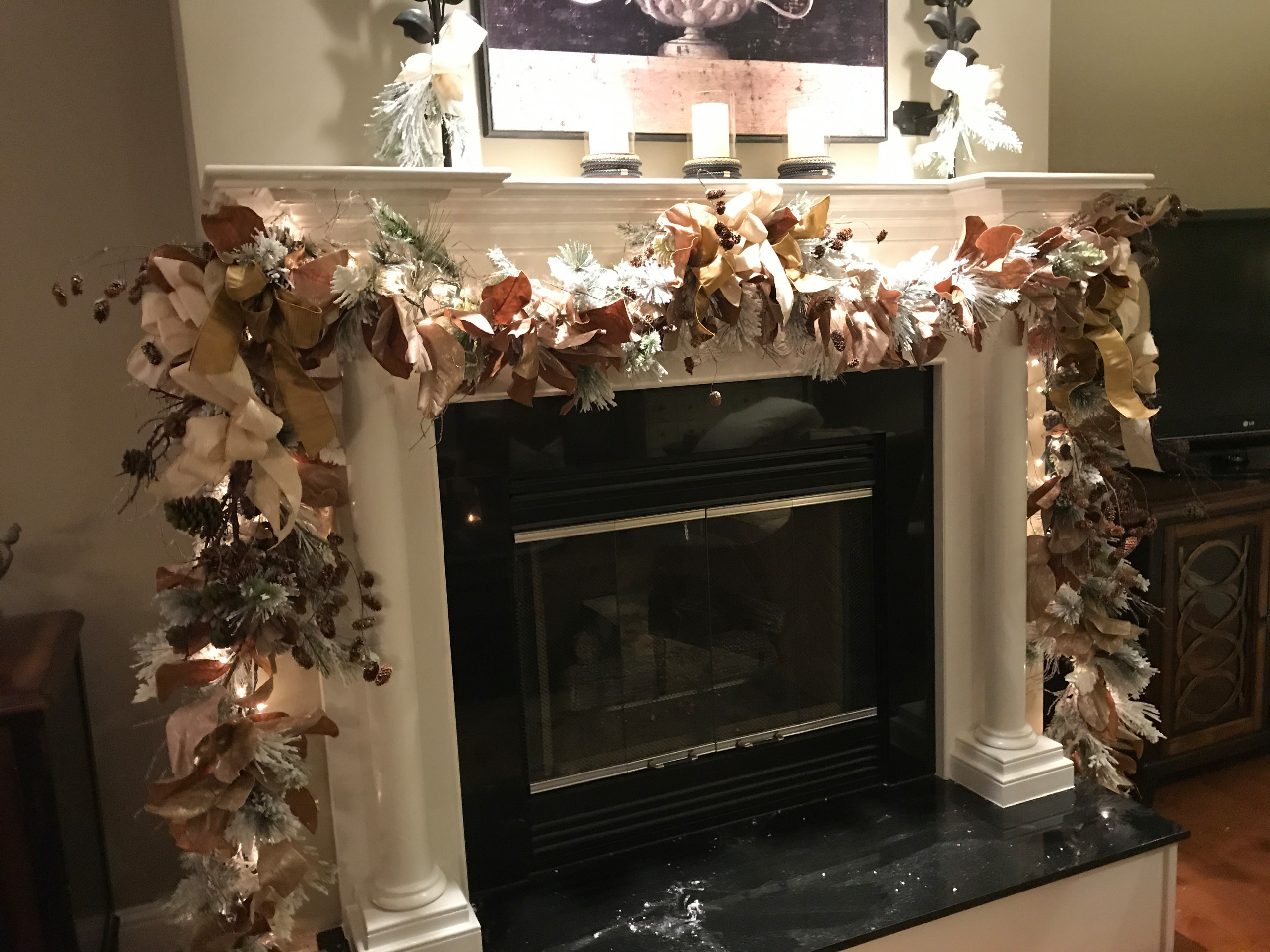 Mantle in Traditional home decked out for Christmas