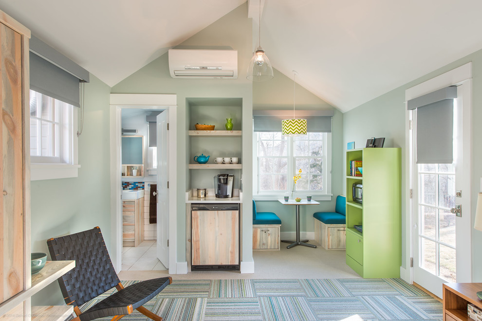 Inspiration for a transitional living room remodel in Denver with blue walls