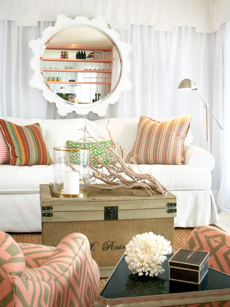 Example of a large beach style open concept living room design in Boston with no fireplace and white walls