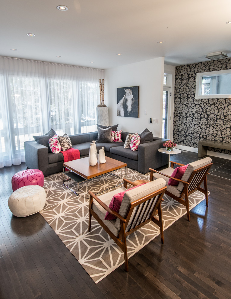 Example of a trendy open concept dark wood floor and brown floor living room design in Calgary with white walls