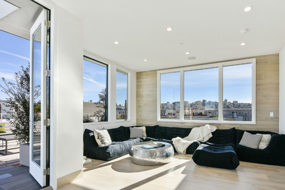 Living room - contemporary enclosed light wood floor and beige floor living room idea in San Francisco with white walls