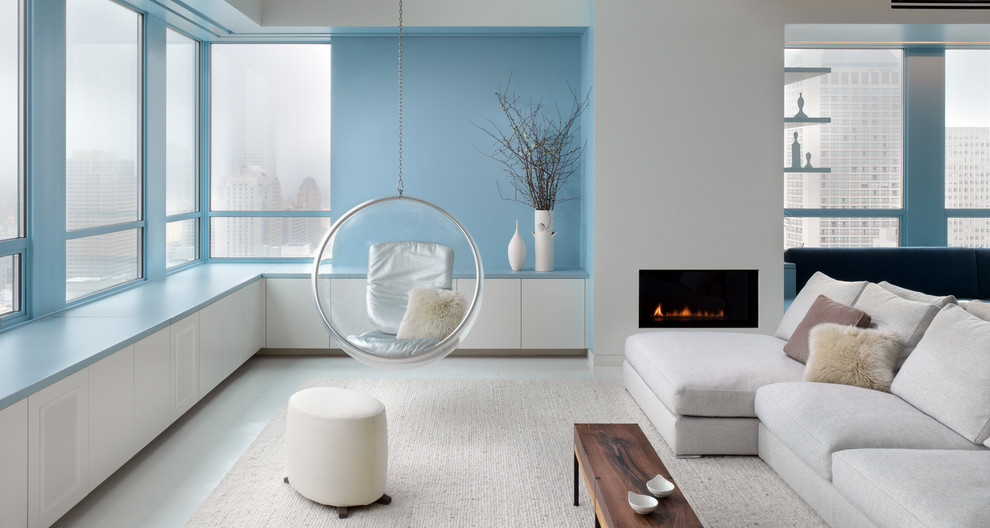 Living room - contemporary open concept and formal living room idea in San Francisco with blue walls and a ribbon fireplace