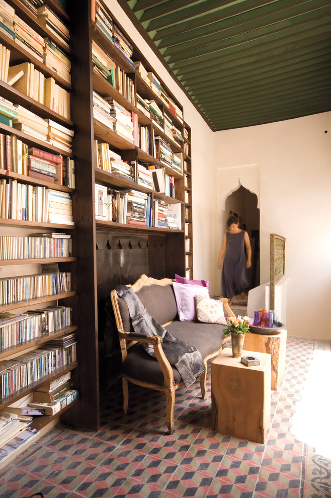Inspiration for a mediterranean enclosed living room library remodel in New York