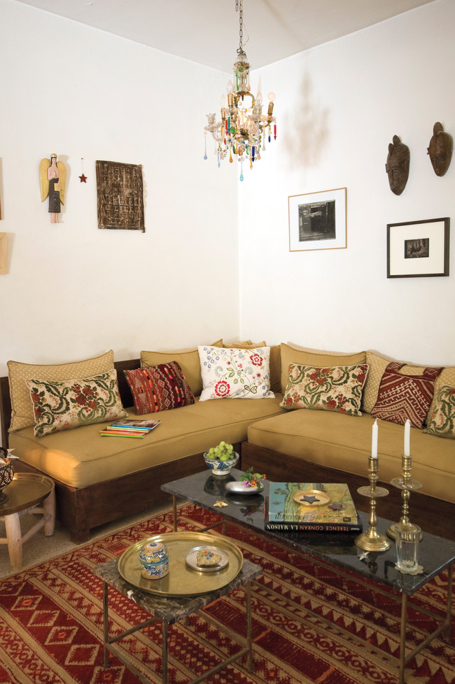Example of a tuscan living room design in New York with white walls
