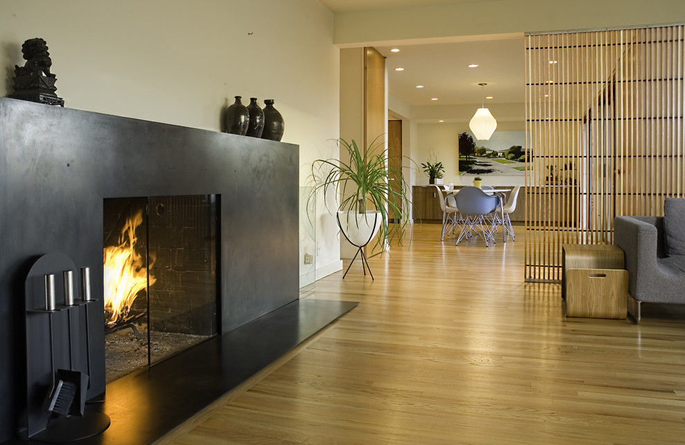 Inspiration for a modern living room remodel in Seattle with beige walls, a standard fireplace and a metal fireplace