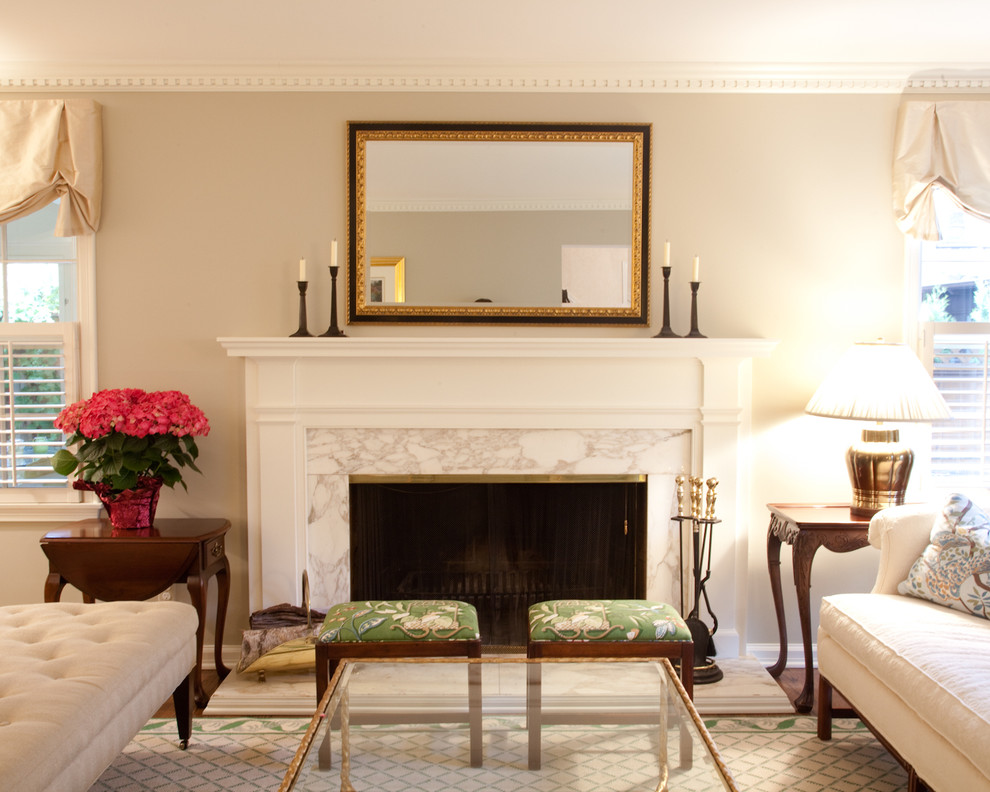 Elegant formal living room photo in Milwaukee with beige walls and a standard fireplace