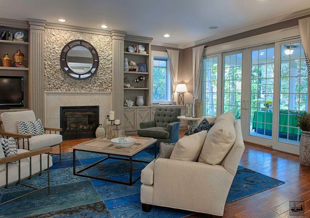 Inspiration for a large contemporary enclosed medium tone wood floor and brown floor living room remodel in DC Metro with gray walls, a standard fireplace, a stone fireplace and a tv stand