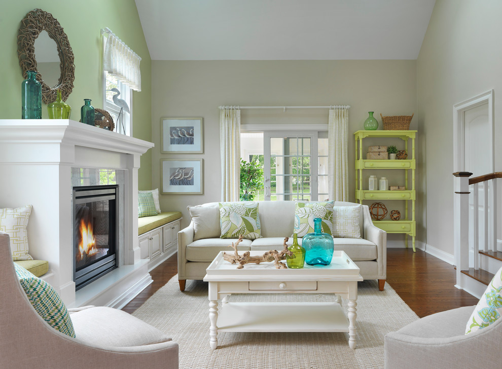 Living room - mid-sized coastal enclosed and formal medium tone wood floor living room idea in Boston with beige walls, a standard fireplace, a stone fireplace and no tv