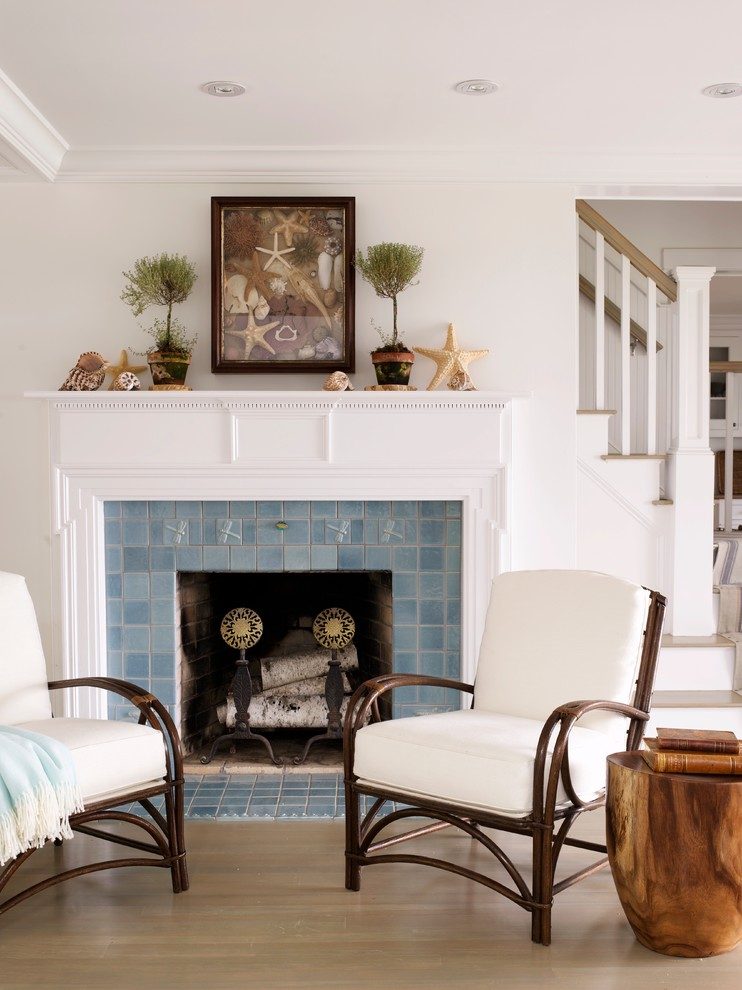 Living room - coastal formal light wood floor living room idea in New York with white walls, a standard fireplace and a tile fireplace