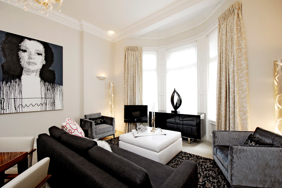 Living room - transitional open concept carpeted living room idea in London with beige walls and a tv stand