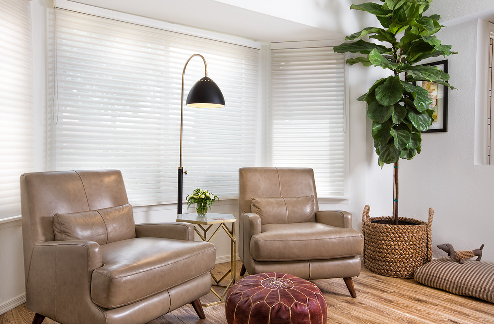 Example of a mid-sized trendy open concept living room design in Phoenix with white walls
