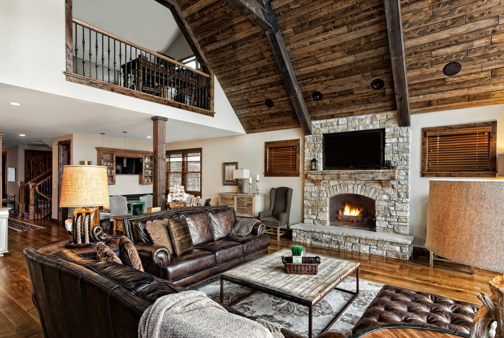 Inspiration for a timeless open concept living room remodel in Chicago with a standard fireplace, a stone fireplace and a wall-mounted tv