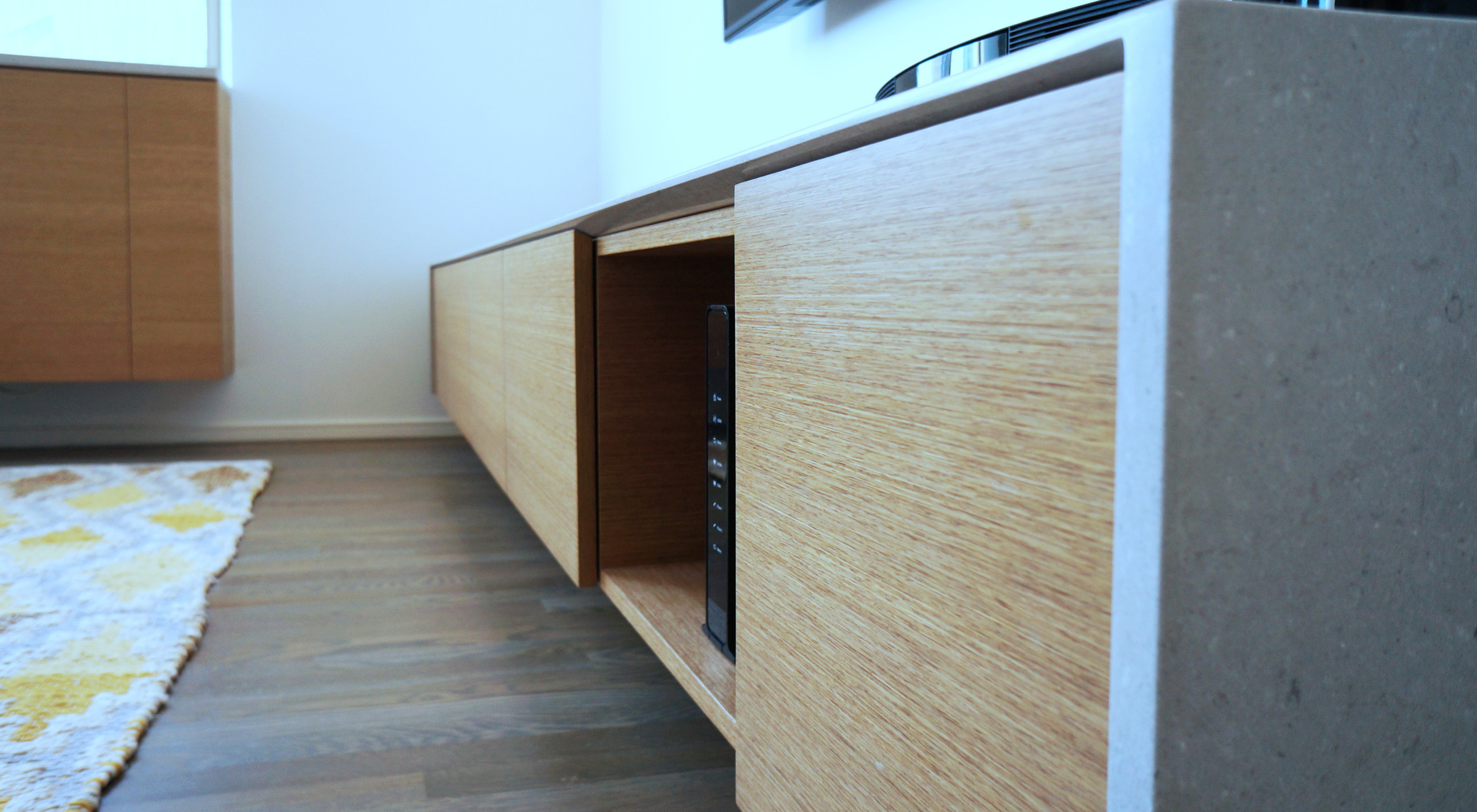 Media cabinet  - caesarstone wrapped counter and wood veneer