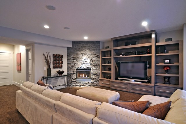 Media Center And Stacked Stone Fireplace Contemporary