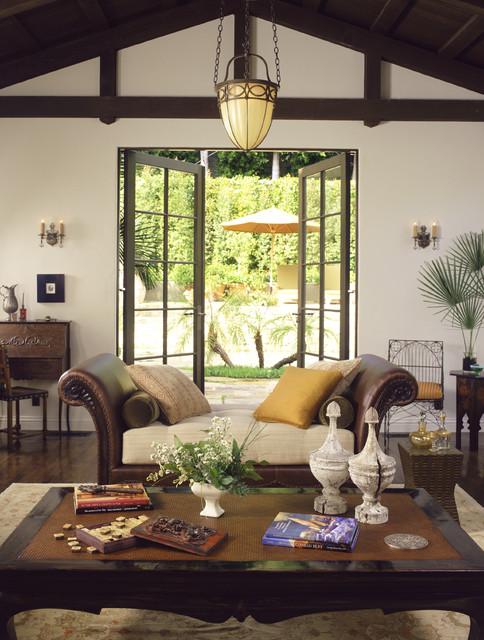 Cool Mediterranean Living Room by Tommy Chambers Interiors Inc