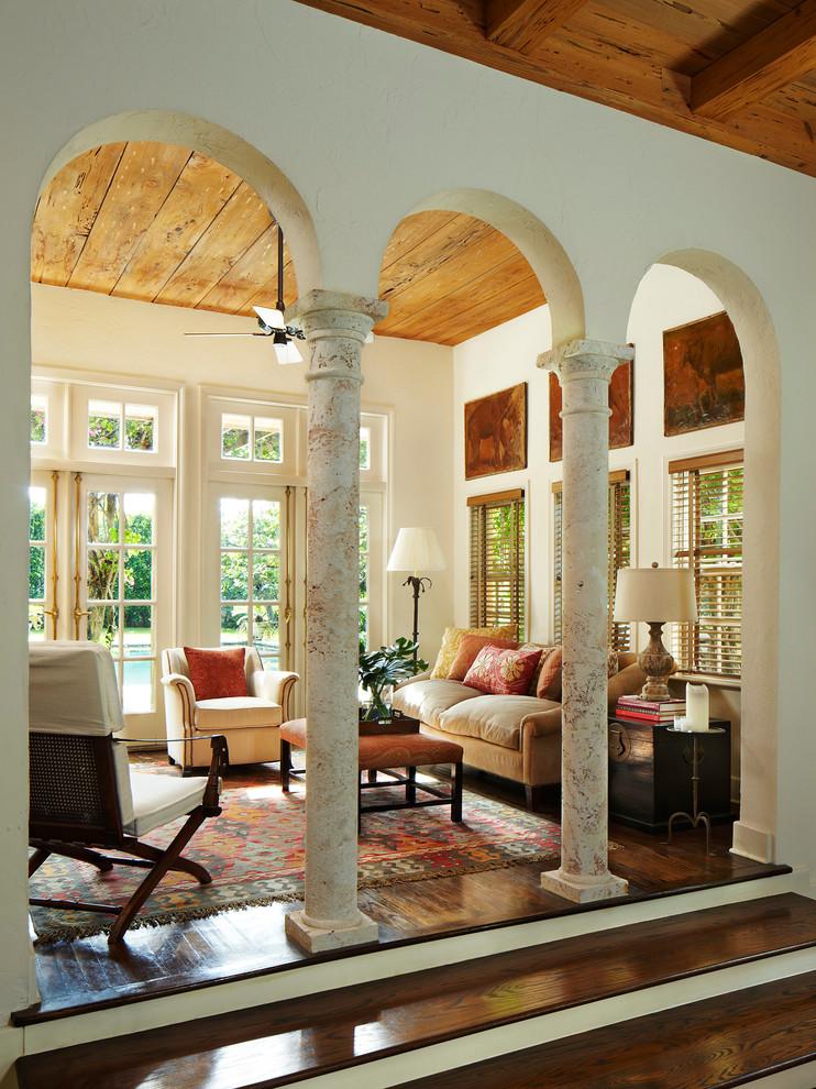 Living room - mediterranean dark wood floor living room idea in Miami with beige walls