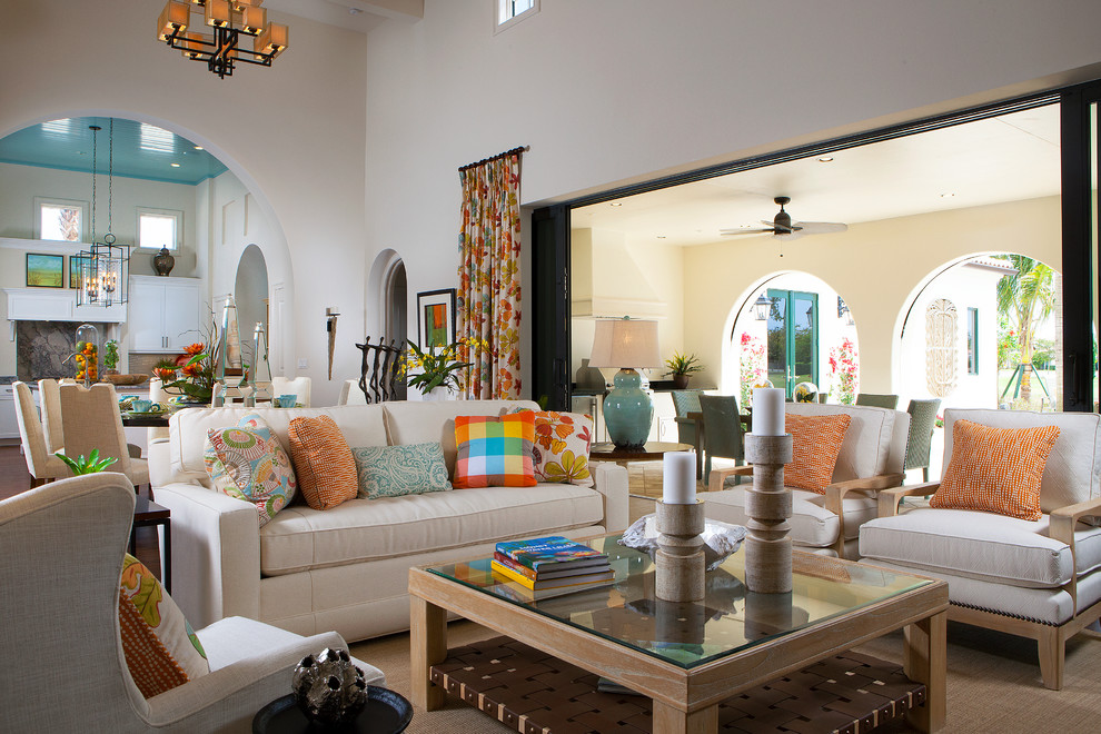 Living room - mediterranean formal and open concept living room idea in Other with beige walls