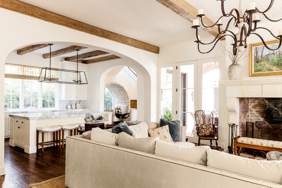 Mediterranean open plan living room in Other with white walls.